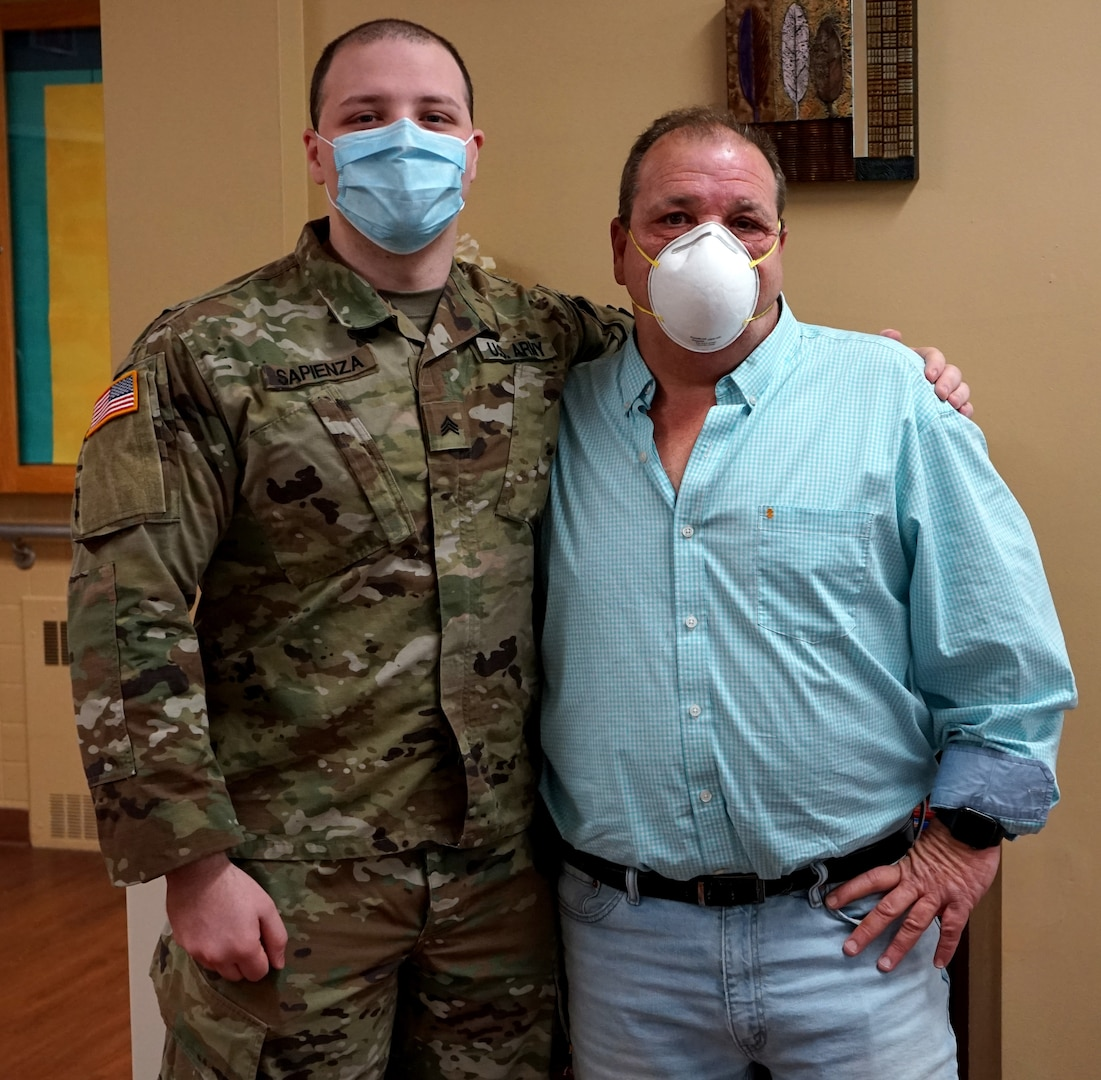 Sgt. Alec Sapienza, left, combat medic with the 108th Medical Area Support Company, 213th Regional Support Group, Pennsylvania National Guard, and his father Joseph Sapienza, director of maintenance/life safety for Pleasant Valley Manor nursing home in Stroudsburg, Pa., May 21, 2020. Alec and other members of the Pennsylvania National Guard are helping out at the nursing home.