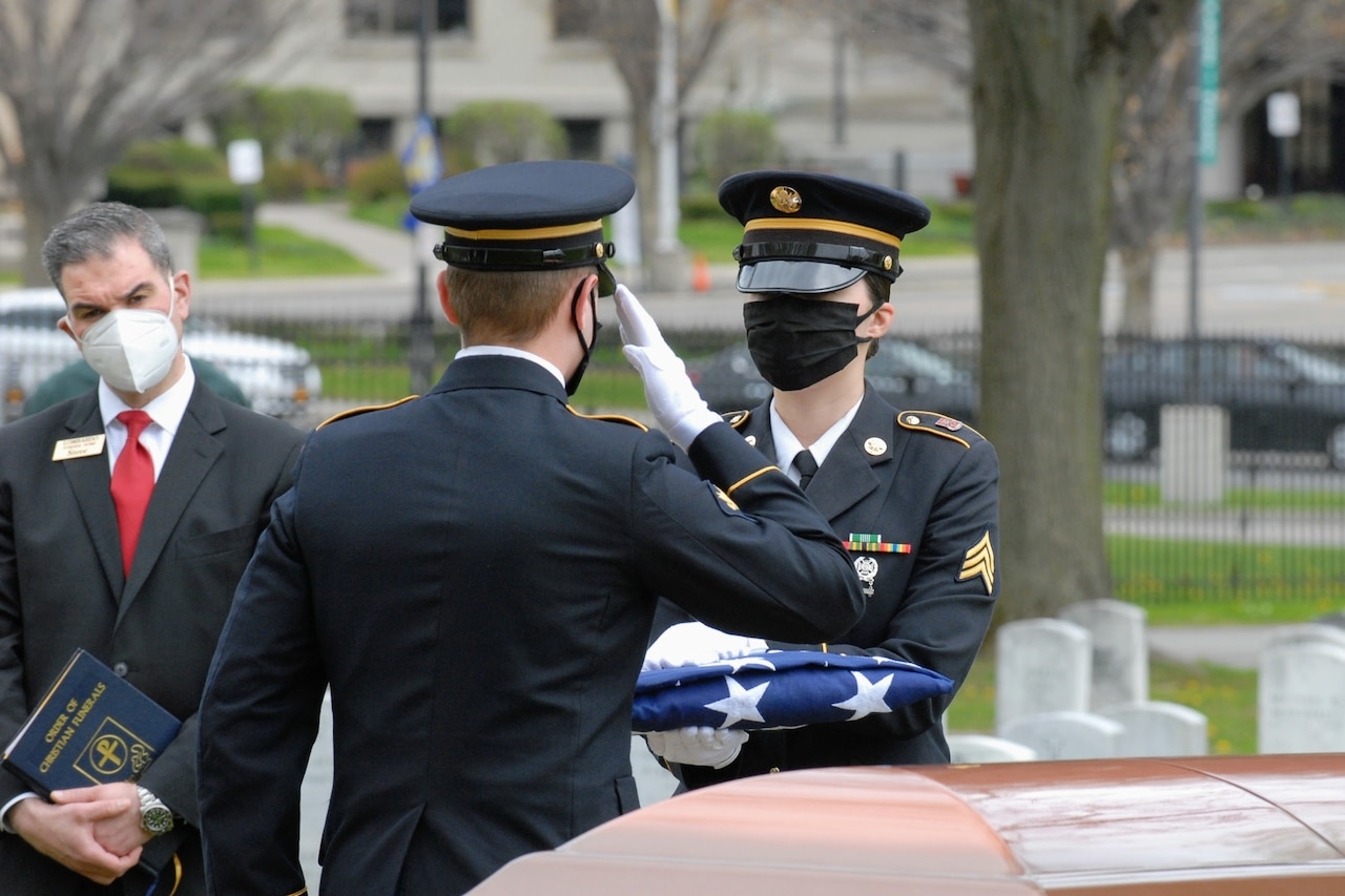onor guard soldiers at a military funeral.