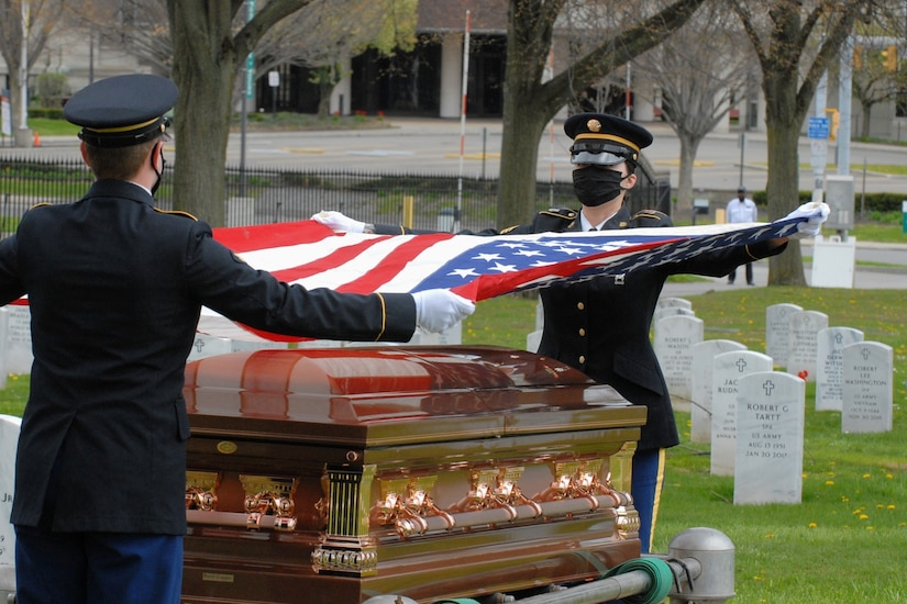 Honor guard soldiers at a military funeral.