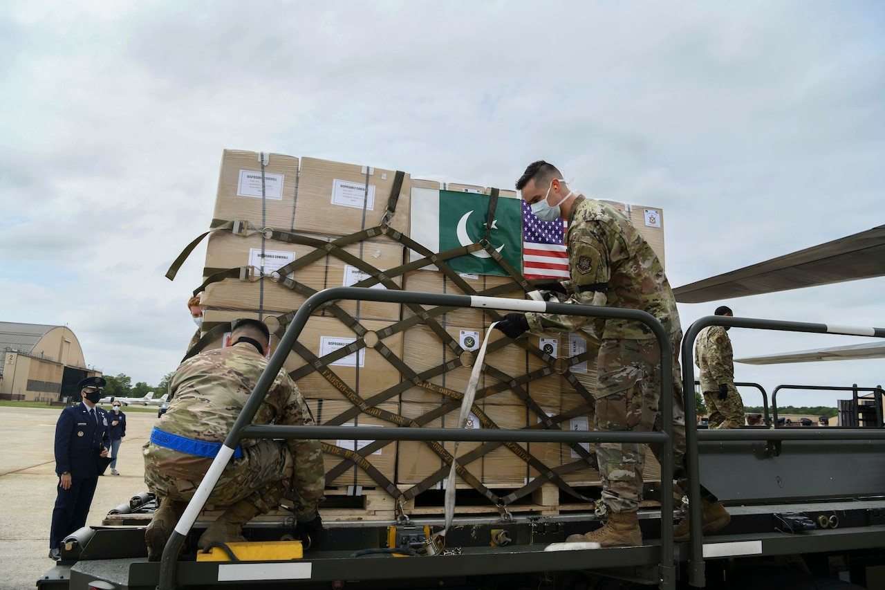 U.S. airmen unload a Pakistan Air Force C-130.