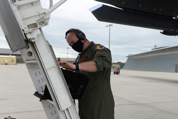 Aviator looks at checklist