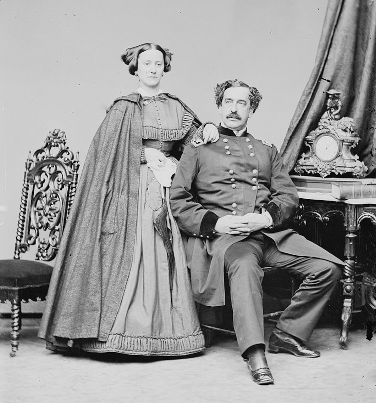 A mid-19th century couple pose for a portrait.