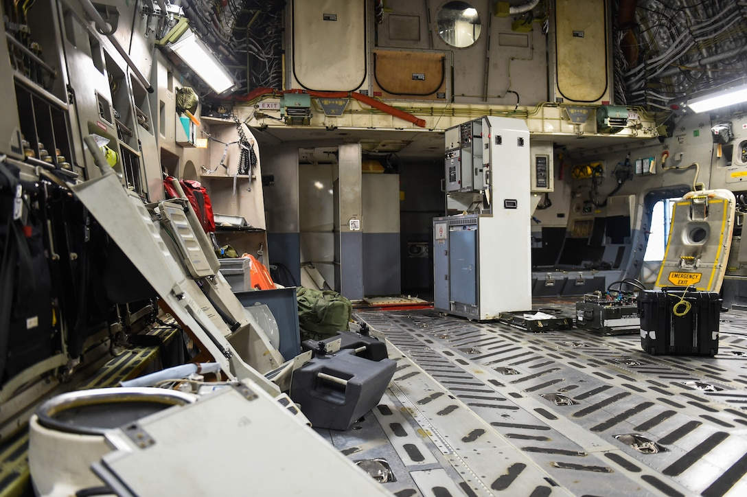A C-17 Globemaster III undergoes a major interior refurbishment during a home station check on Joint Base Lewis-McChord, Wash., May 20, 2020. Every 180 days a C-17 receives a home station check, during which it undergoes a thorough safety and functionality inspection. (U.S. Air Force photo by Airman 1st Class Mikayla Heineck)