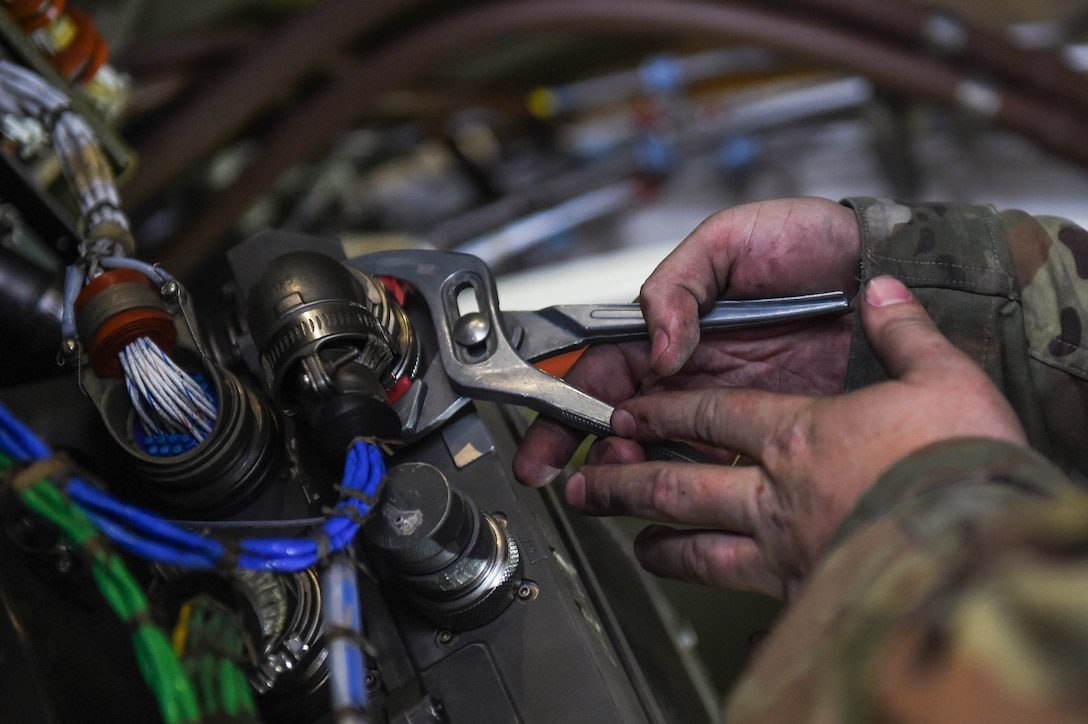Staff Sgt. Jonathan Daniels, 62nd Maintenance Squadron jet mechanic, tightens a part on the electronic engine system for a C-17 Globemaster III on Joint Base Lewis-McChord, Wash., May 20, 2020. Jet mechanics specialize in work on the engines of C-17s, whereas crew chiefs conduct maintenance on other areas of the aircraft. (U.S. Air Force photo by Airman 1st Class Mikayla Heineck)
