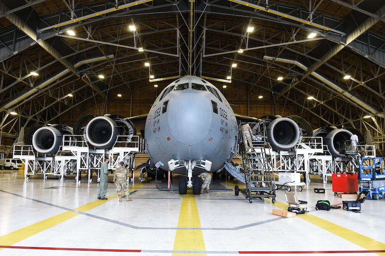 Airmen in the 62nd Maintenance Squadron conduct a home station check on a C-17 Globemaster III inside a hangar on Joint Base Lewis-McChord, Wash., May 20, 2020. Every 180 days a C-17 receives a home station check, during which it undergoes a thorough safety and functionality inspection. (U.S. Air Force photo by Airman 1st Class Mikayla Heineck)