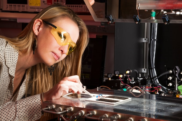 Woman looking at a piece of technical equipment