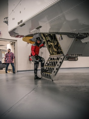 NASA astronaut Bob Behnken stops for the camera moments before going inside the Air Force Research Laboratory's centrifuge for his spin during testing Nov. 2, 2018 at the Air Force Research Laboratory's centrifuge facility. (U.S. Air Force photo / Keith Lewis)