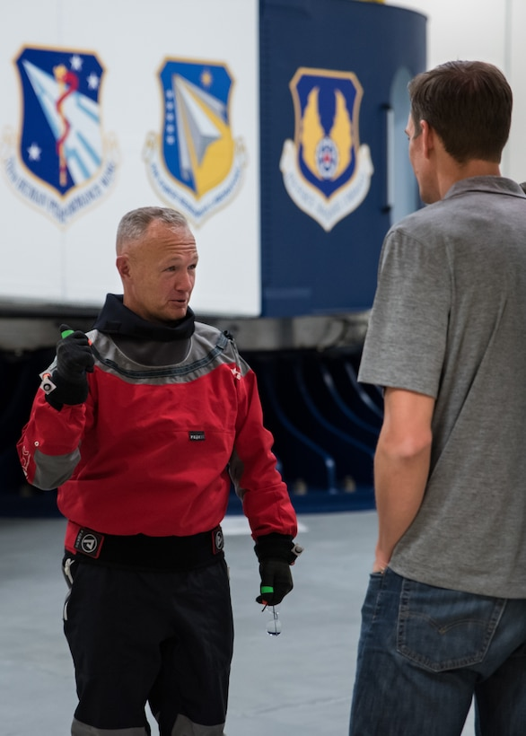 NASA astronaut Douglas Hurley speaks with a NASA engineer just before getting into the Air Force Research Laboratory's centrifuge. Ten astronauts participated in the testing Nov. 1-2, 2018 – one with Boeing and nine with NASA. (U.S. Air Force photo / Richard Eldridge)