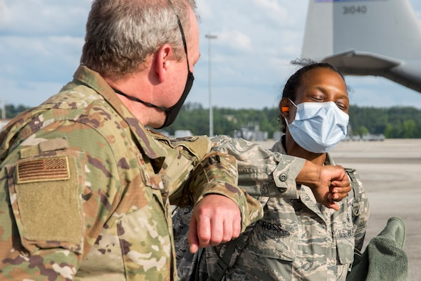 Maj. Enrika Ross, 94th Aeromedical Staging Squadron nursing OIC, greets Col. John Gillespie, 94th ASTS commander, on the flightline at Dobbins Air Reserve Base, Ga. shortly after arriving via a Dobbins C-130H3 Hercules on May 28, 2020. Ross was one of four Dobbins nurses who mobilized to New York City's Queens Hospital, where she worked as a nurse in the medical-surgical unit as part of the whole-of-government response to the COVID-19 pandemic. (U.S. Air Force photo/Andrew Park)