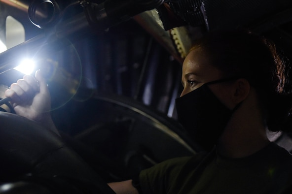 Airman 1st Class Kathryn Danley, 62nd Maintenance Squadron jet mechanic, adjusts machinery inside a C-17 Globemaster III engine on Joint Base Lewis-McChord, Wash., May 20, 2020. Every 180 days a C-17 receives a home station check, during which it undergoes a thorough safety and functionality inspection. (U.S. Air Force photo by Airman 1st Class Mikayla Heineck)