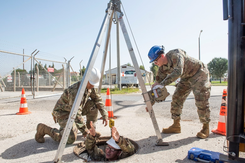 """Cable dawgs"" assigned to the 39th Communications Squadron carry their shovels after an afternoon of work May 11, 2020, at Incirlik Air Base, Turkey. Cable and antenna systems Airmen, popularly called ""cable dawgs,"" are often mistaken for civil engineers because their jobs take place outdoors and involve vigorous manual labor. (U.S. Air Force photo by Staff Sgt. Joshua Magbanua)"