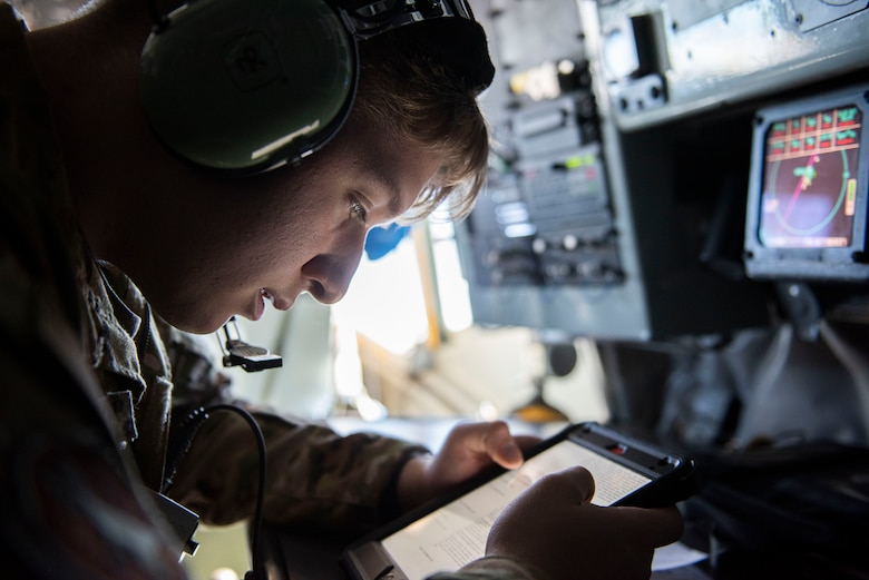 Photo of Airman reading technical instructions