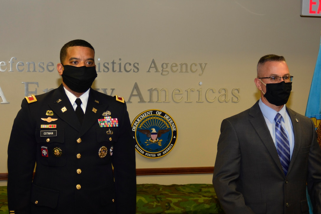 An Army officer and a senior civilian member stand together