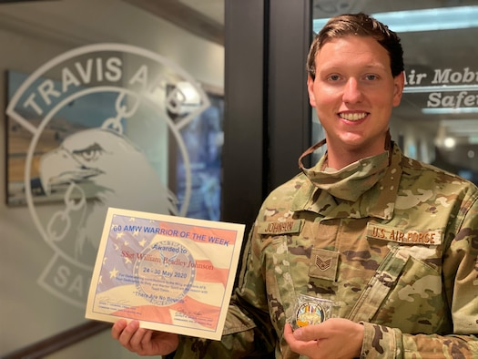 An Airman holds his certificate he received for being the warrior of the week.