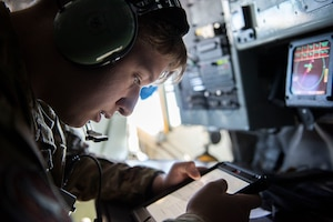 U.S. Air Force Airman 1st Class Austin Buller, 22nd Expeditionary Air Refueling Squadron boom operator, reads technical instructions during a training flight over the Black Sea May 29, 2020. Participation in multinational exercises enhances our professional relationships and improves overall coordination with allies and partner militaries during times of crisis. (U.S. Air Force photo by Staff Sgt. Joshua Magbanua)