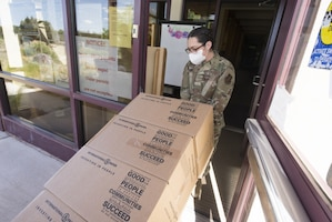 Members from the 150th Mission Support Group work with our 210th RED HORSE Squadron to complete another food delivery mission in Santa Fe, N.M.