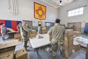 The New Mexico National Guard Joint Task Force continue packaging food for scheduled deliveries.