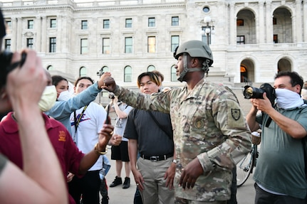 Master Sgt. Acie Matthews of the Minnesota National Guard engaged with protesters to show solidarity and request they comply with the state curfew at the grounds of the Minnesota State Capitol in St. Paul June 1, 2020.