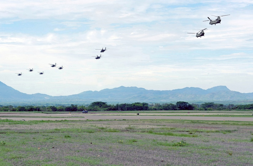 """U.S. Army soldiers assigned to Joint Task Force Bravo conducted a large formation helicopter exercise May 28 out of Soto Cano Air Base, Honduras. The exercise involved participation from the U.S. Army South's 1-228 Aviation Regiment """"Winged Warriors"""" and the use of 10 U.S. Army CH-47 Chinooks and UH-60L Blackhawk helicopters."""