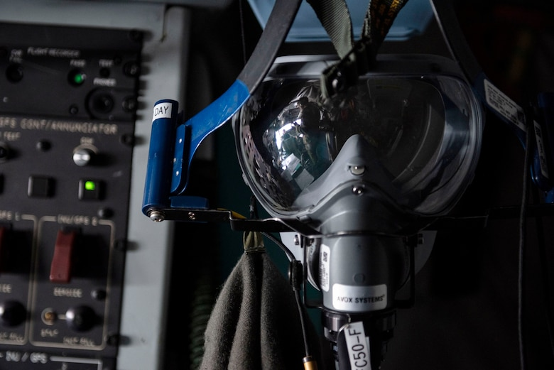 An oxygen mask hangs in the cockpit of a U.S. KC-135 Stratotanker assigned to 22nd Expeditionary Air Refueling Squadron during a training flight over the Black Sea May 29, 2020. Training outside the U.S. enables aircrew and Airmen to become familiar with other theaters and airspace, and enhances enduring skills and relationships necessary to confront a broad range of global challenges in support of the National Defense Strategy. (U.S. Air Force photo by Staff Sgt. Joshua Magbanua)