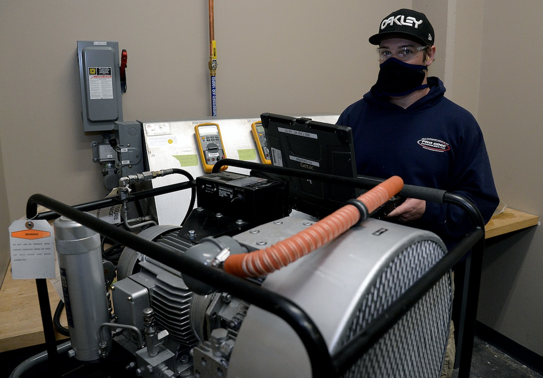 Skylar Cleveland, 581 Missile Maintenance Squadron powered support system mechanic, checks test results while performing a 4-hour run test during periodic depot maintenance on a shock isolator air compressor on Apr. 28, 2020, at Hill Air Force Base, Utah.