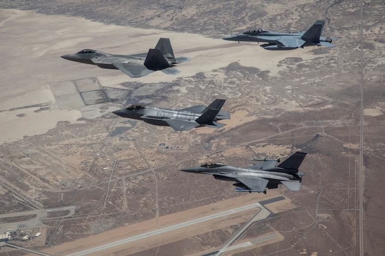 Various aircraft participating in Orange Flag Exercise (OFE) fly over Edwards Air Force Base, California,  during OFE 19-2.  COVID-19 telework operations have created new opportunities for engineers from the 412th Test Wing teams to spend more time on software development environments to support weapons analysis, and to support multi-platform multi-service analysis for large force exercises such as OFE.