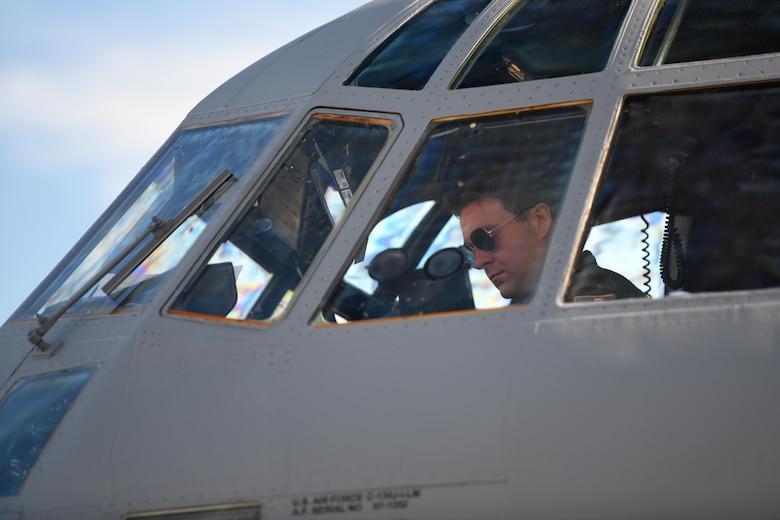 Maj. Nathan Eldredge, 62nd Airlift Squadron instructor pilot, completes pre-flight checks on a C-130J Super Hercules at Little Rock Air Force Base, Arkansas.