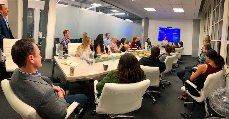 Fellows take part in a meeting with Brian O'Malley, a partner at Forerunner Ventures in San Francisco, in March. (Maj. Stacie N. Shafran)
