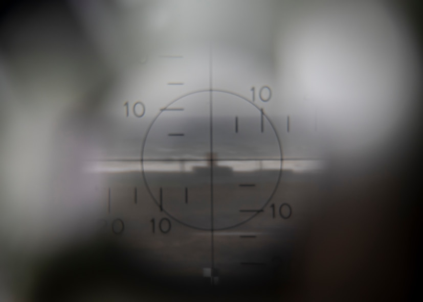 The view inside a M2A2 aiming scope at Draughon Range near Misawa Air Base, Japan, May 20, 2020. The image depicts the F-16 Fighting Falcon's impact point when dropping inert munitions. This premier range allows military forces to safely employ inert munitions, enhancing the readiness of Misawa's F-16 Fight Falcon pilots and other U.S. personnel to maintain the defense of Japan. Draughon Range provides realistic training for pilots by simulating enemy detection and attacks with threat emitters. (U.S. Air Force photo by Airman 1st Class China M. Shock)