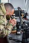 U.S. Air Force Chief Master Sgt. John Alsvig, the 35th Fighter Wing command chief, looks into a M2A2 aiming scope at Draughon Range near Misawa Air Base, Japan, May 20, 2020. The M2A2 aiming scope is the back-up scoring system for air-to-ground weapons employment for aircraft such as the F-16 Fighting Falcon and Japan Air Self-Defense Force F-35. These jets use the range to enhance the training and readiness of Misawa's fighter pilots, ensuring Team Misawa maintains its combat readiness and continues its mission of defending Japan and protecting U.S. interests in the Pacific. (U.S. Air Force photo by Airman 1st Class China M. Shock)