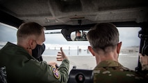 U.S. Air Force Col. Kristopher W. Struve, left, the 35th Fighter Wing commander, showcases Draughon Range to Lt. Gen. Kevin B. Schneider, right, the U.S. Forces Japan and Fifth Air Force commander, at Draughon Range near Misawa Air Base, Japan, May 20, 2020. Draughon range is the premier training site where Misawa's F-16 Fighting Falcons employ inert munitions and defend against simulated surface-to-air threats. The range is also utilized by many other USFJ units, providing critical training to combat search and rescue, mobility and fighter units throughout Japan. (U.S. Air Force photo by Airman 1st Class China M. Shock)