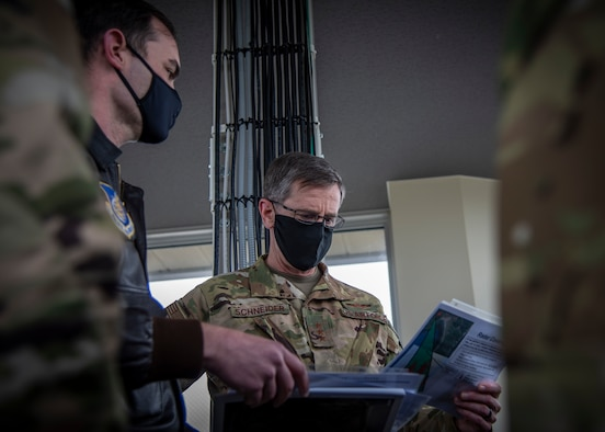 U.S. Air Force Maj. Daniel House, left, the 35th Operations Support Squadron assistant director of operations, talks to Lt. Gen. Kevin B. Schneider, right, the U.S. Forces Japan and Fifth Air Force commander, at Draughon Range near Misawa Air Base, Japan, May 20, 2020. Draughon Range is the premier air-to-ground training site located in Japan, focusing on suppression of enemy air defense air operations. Members of the 35th Fighter Wing and other units throughout the Western Pacific train at the range to focus on SEAD and munition employment, combat search and rescue, and survival, evasion, resistance, and escape, ultimately enhancing the readiness and lethality of U.S. forces in this region. (U.S. Air Force photo by Airman 1st Class China M. Shock)