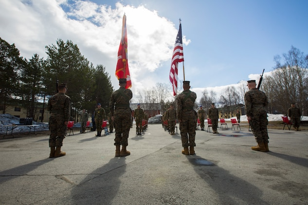 U.S. Marines and Norwegian Soldiers stand at attention