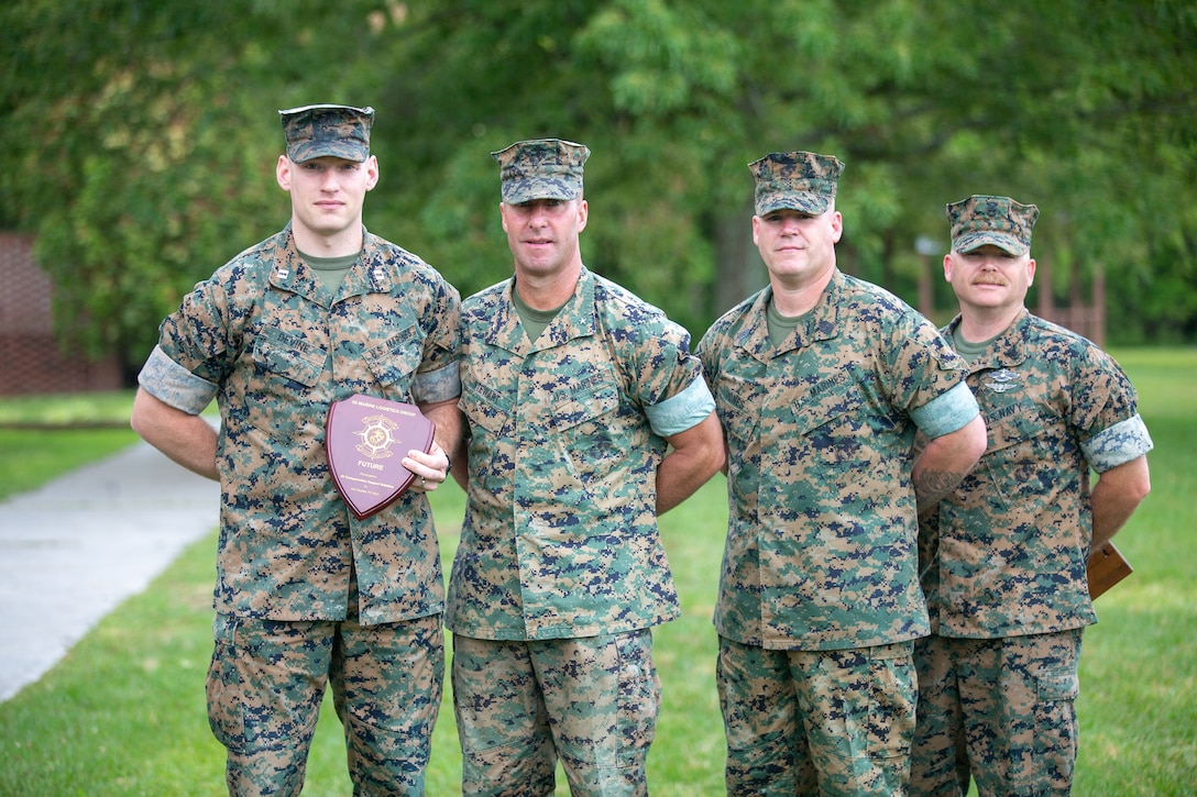 Marines with 2nd Marine Logistics Group receive unit awards as part of 2nd MLG's unit recognition program at Camp Lejeune, North Carolina, May 28, 2020. (U.S. Marine Corps photo by Lance Cpl. Scott Jenkins)