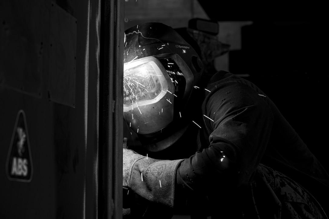 A U.S. Marine welds a Quadcon on Camp Kinser, Okinawa, Japan, May 19.