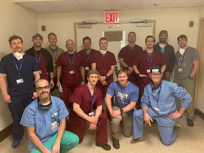 Pararescue Airmen assigned to the 103rd Rescue Squadron of the New York Air National Guard's 106th Rescue Wing who assisted medical staff at Elmhurst Hospital in Queens, N.Y., during the COVID-19 pandemic, with members of the hospital staff.