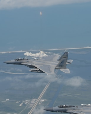 Florida Air National Guard F-15s from the 125th Fighter Wing, Jacksonville, Florida, conducted a North American Aerospace Defense Command (NORAD) mission, defending the skies over the Kennedy Space Center during the first manned space launch in nearly nine years, Cape Canaveral, Florida, May 30, 2020. (U.S. Air National Guard photo by Capt. Maxwell Anthony.)