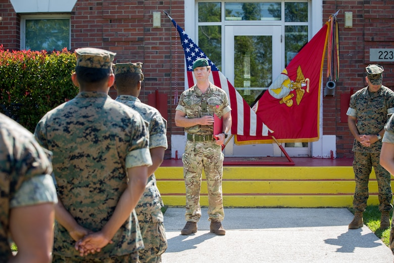 British Royal Marine Maj. James A. Fuller, the future operations officer with 2nd Marine Regiment, 2nd Marine Division, addresses U.S. Marines with 2nd Marine Regiment during his Bronze Star Medal award ceremony at Camp Lejeune, North Carolina, June 3, 2020. Fuller received the Bronze Star for his distinctive contributions and efforts as the assistant operations officer with Task Force Southwest 19.1, U.S. Marine Corps Forces Central Command in Afghanistan. Fuller directly increased TSFW's combat effectiveness and operational reach in Helmand Province. (U.S. Marine Corps photo by Lance Cpl. Jacqueline Parsons)