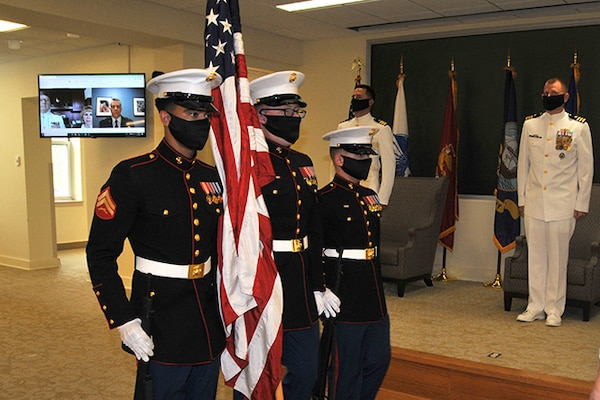 Color guard presents nation's flag at ceremony