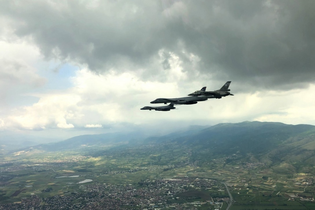 Two U.S. Air Force aircraft and one Greek air force aircraft fly near one another.