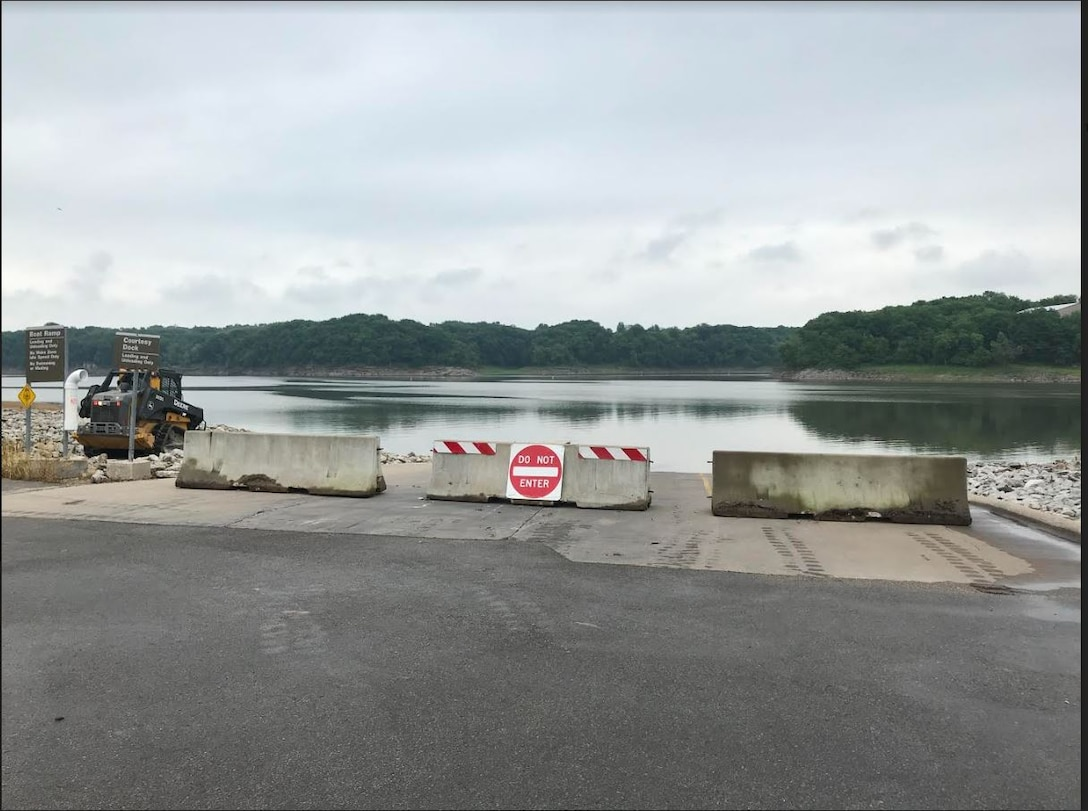 Barricades block access to the West Overlook Day Use Boat Ramp at Coralville Lake.