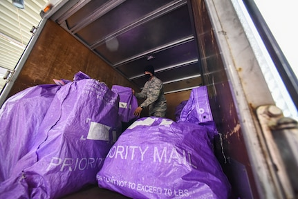 35th LRS and 35th FSS Join Forces to Keep Post Office Ops Moving