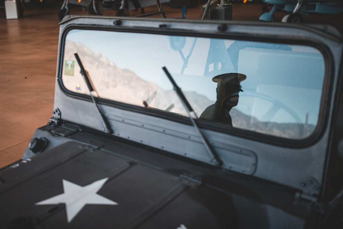 A U.S. Marine awaits the commencement of the Memorial Day ceremonial flyover at the Palm Springs Air Museum, Palm Springs, Calif., May 25.