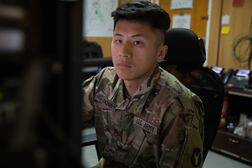 Staff Sgt. Nhia Xiong prepares to print a tactical map in his office while he is deployed to the Middle East with the Headquarters & Headquarters Company, 34th Expeditionary Combat Aviation Brigade. His role as the geospatial non-commissioned officer in charge is to oversee the creation and printing of maps used by other units in his area of operations for missions that support of Operation Spartan Shield and Operation Inherent Resolve.