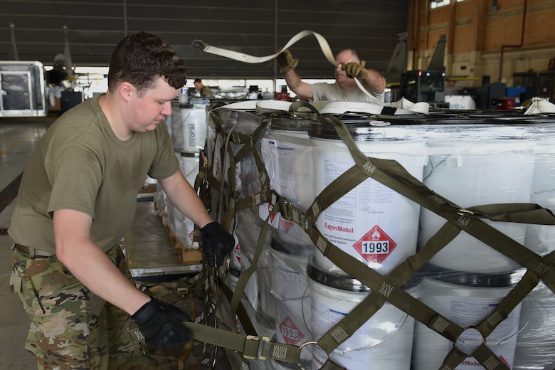 Photo of Airman securing a pallet