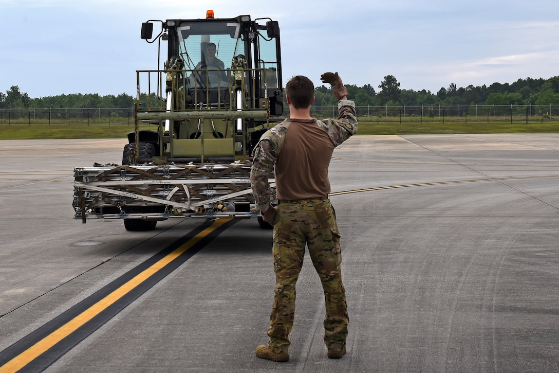 Photo of Airman guiding a forklift