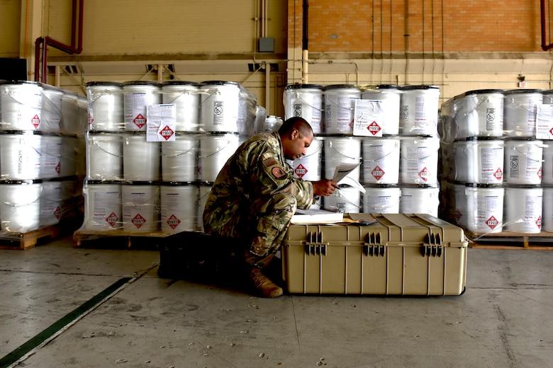 Photo of Airman checking hazmat documentation