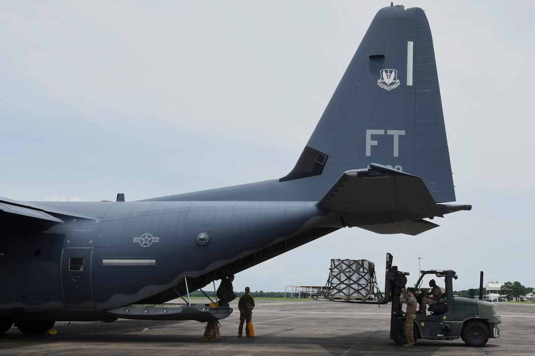 Photo of Airman loading a pallet into an aircraft