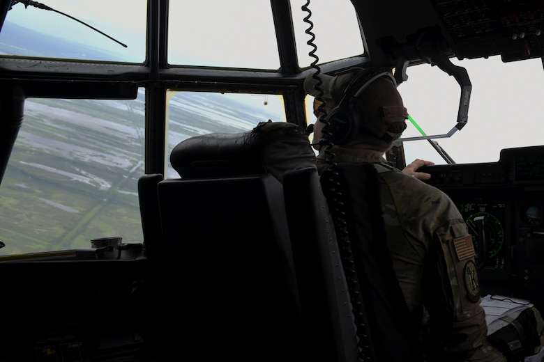 Photo of Airman in aircraft