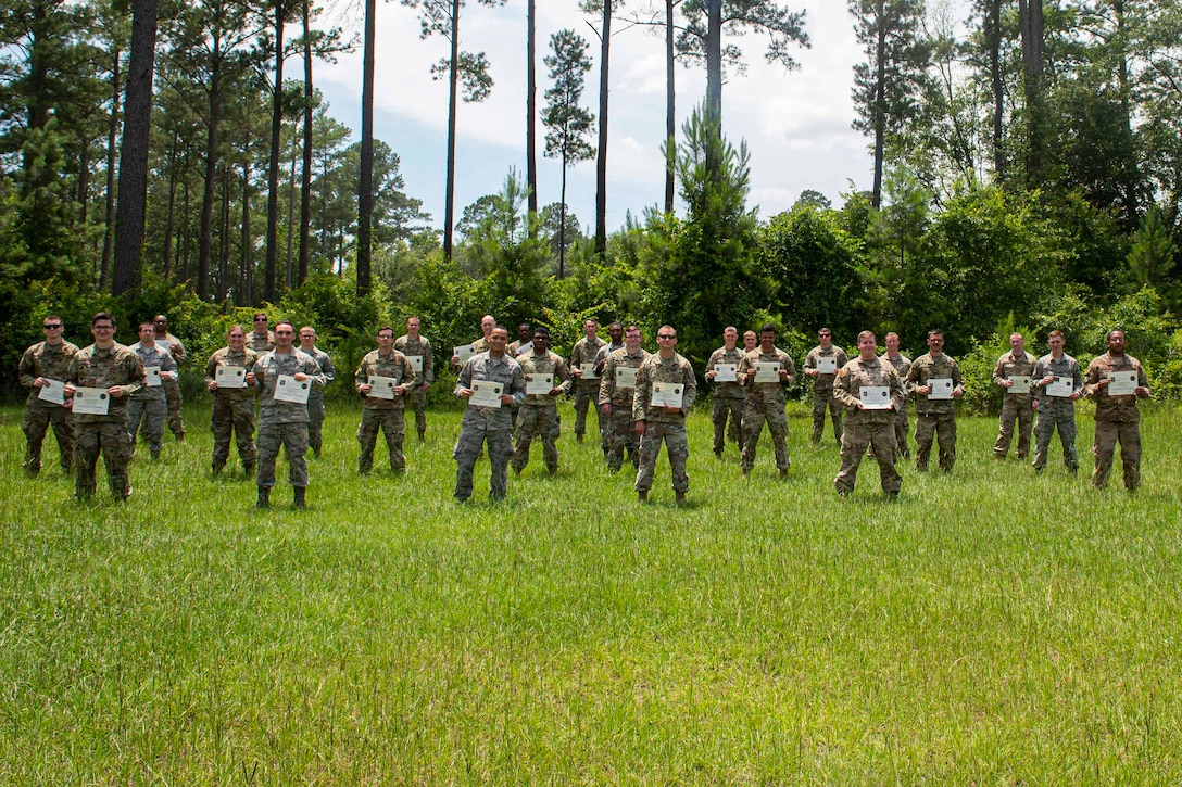Photo of graduates of the Multi-Capable Airmen course posing for a photo.